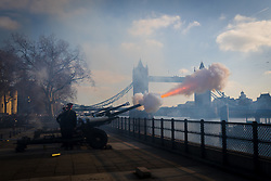 © Licensed to London News Pictures. 06/02/2020. London, UK. The Honourable Artillery Company fire a 62 gun salute from Gun Wharf at the Tower of London in front of Tower Bridge to mark Her Majesty the Queen's accession to the throne. Photo credit: Vickie Flores/LNP