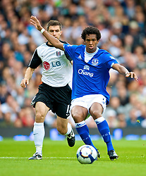 LONDON, ENGLAND - Sunday, September 13, 2009: Everton's Jo and Fulham's Aaron Hughes during the Premiership match at Craven Cottage. (Photo by David Rawcliffe/Propaganda)