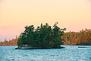 Island and shore of Lake of The Woods at sunrise<br />