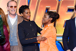 Paul Bettany (left) and Letitia Wright (centre) poses with a Marvel cosplayer attending the Avengers: Infinity War UK Fan Event held at Television Studios in White City, London.