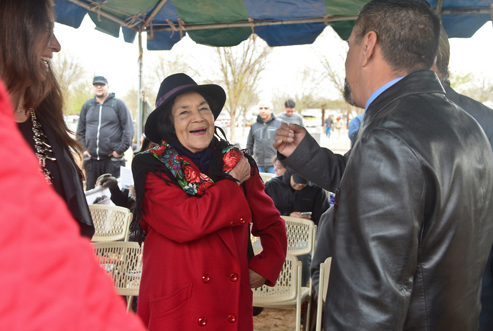 Dolores Huerta, the activist who started the National Farm Workers Association with Cesar Chavez, is welcomed by local officials during the naming ceremony for the Dolores Huerta Gateway Park before the annual Cesar Chavez Day march, Saturday, April 1, 2017, in Albuquerque, N.M. (Marla Brose/Albuquerque Journal)