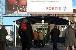 People pass through a security check point before entering an extraordinary meeting of Fortis shareholders at the Brussels Expo Center, in Brussels, Belgium, on Friday, Dec. 19, 2008. Fortis, the insurer that was once Belgium?s largest financial-services firm, clashed with some investors at a meeting in Brussels by sticking to an agreement to sell the Belgian insurance business to BNP Paribas SA..(Photo © Jock Fistick)