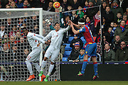 Liverpool goalkeeper Simon Mignolet (22)  punches the ball clear during the Barclays Premier League match between Crystal Palace and Liverpool at Selhurst Park, London, England on 6 March 2016. Photo by Simon Davies.