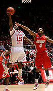 Utah guard Josh Watkins (15) attempts to score against New Mexico forward Chad Adams (4) during the first half of an NCAA college basketball game, Wednesday, Jan. 19, 2011, in Salt Lake City, Utah. Watkins scored 22 points in Utah's 82-72 win. (AP Photo/Colin E Braley)