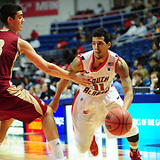 South Alabama's guard Freddie Goldstein (11) drives around a Denver player in the second half of play in Mobile, AL. Denver defeated South Alabama 67-50 on January 7, 2012.