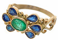 teardrop blue jewels on a gold ring with a green glass oval center