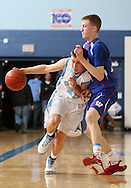 Jefferson's Joby Frey (22) tries to get around Washington's Josh Oglesby (24) during the first half of their game at Jefferson High School in Cedar Rapids on Friday February 6, 2009. Washington led 33-14 at halftime.