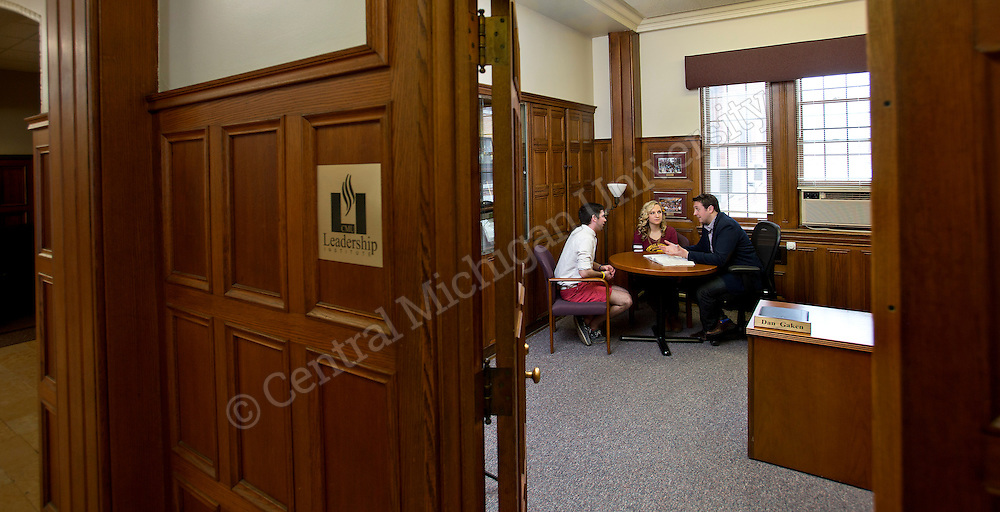 Leadership Institute director Dan Gaken talks with leadership students in his office in Powers Hall.  Photo by Steve Jessmore/Central Michigan University