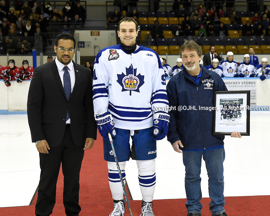 MARKHAM, - Feb 26, 2016 -  Ontario Junior Hockey League game action between Stouffville and Markham at the Markham Centennial Community Centre, ON. Marco Azzano #91 of the Markham Royals with Anil Sukul Special Assistant to MP Bob Saroya and Mark Mothersill from the Markham Royals during a special pre-game ceremony.  <br /> (Photo by Andy Corneau / OJHL Images)