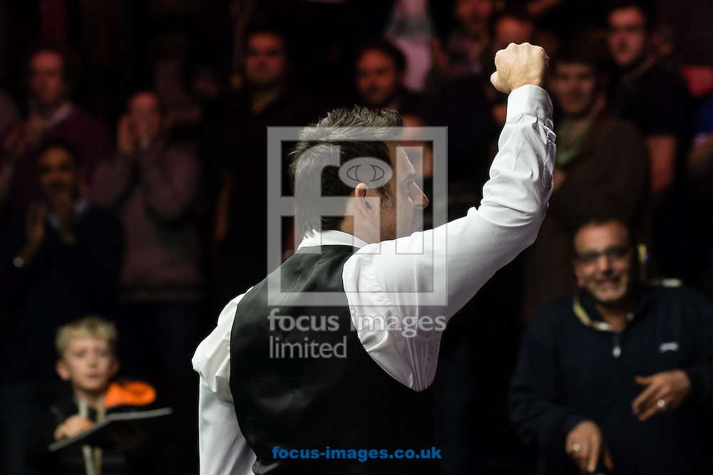 Ronnie O'Sullivan celebrates his 6-4 victory against Marco Fu during the semi-finals of the Dafabet Snooker Masters 2017 at Alexandra Palace, London<br /> Picture by Mark Chappell/Focus Images Ltd +44 77927 63340<br /> 21/01/2017