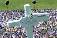 A cross honoring 241 American and 58 French servicemen as well as 6 civilians is seen during a ceremony for which the Delaware Valley Vietnam Veterans planted 65,000 flags at the Falls Township Community Park to honor the servicemen and servicewomen killed in Vietnam, Iraq and Afghanistan Sunday, June 12, 2016 in Fairless Hills, Pennsylvania.  The display is to mark Flag Day, which is June 14. (Photo by William Thomas Cain)