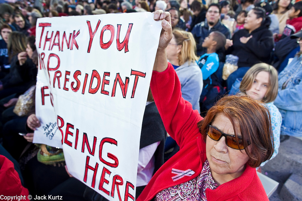 obamatucson 12 JANUARY 2011 - TUCSON, AZ: Delia Zevakkos-Ahmed (CQ), from Tucson, holds up a sign welcoming the President in the University of Arizona stadium Wednesday when it was used for overflow seating during the Together We Thrive Tucson & America event on University of Arizona campus. Tens of thousands of people filed into the stadium to hear President Obama speak. The service is for the victims of Saturday's mass shooting at a Safeway in Tucson.        ARIZONA REPUBLIC PHOTO BY JACK KURTZ..Gabrielle Giffords shooting, mass shooting,