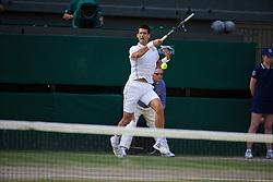 LONDON, ENGLAND - Sunday, July 6, 2014: Novak Djokovic (SRB) plays the winning shot to seal the Gentlemen's Singles Final match 6-7 (7), 6-4, 7-6 (4), 5-7 (4), 6-4 on day thirteen of the Wimbledon Lawn Tennis Championships at the All England Lawn Tennis and Croquet Club. (Pic by David Rawcliffe/Propaganda)