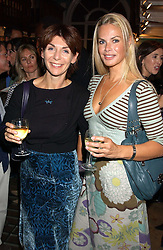 Left to right, actress JO PHILLIPS-LANE and artist EMMA WOOLLARD at a party to celebrate the publicarion of The Meaning of Tingo by Adam Jacot de Boinod held at the Daunt Bookshop, 83 Marylebone High Street, London on 18th October 2005.<br />