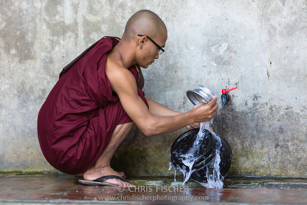 A monk washes dishes following lunch at Mahagandayon Monastery in Mandalay. Mahagandayon Monastery is the largest Buddhist monastery in Myanmar, accomodating more than a thousand young monks.