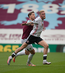 James Tarkowski of Burnley (L) and Oliver McBurnie of Sheffield United in action - Mandatory by-line: Jack Phillips/JMP - 05/07/2020 - FOOTBALL - Turf Moor - Burnley, England - Burnley v Sheffield United - English Premier League