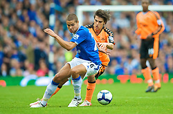 LIVERPOOL, ENGLAND - Sunday, August 30, 2009: Everton's Jack Rodwell and Wigan Athletic's Jordi Gomez during the Premiership match at Goodison Park. (Photo by David Rawcliffe/Propaganda)