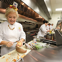 "Leslie Geoghegan, a ""Celebrity Chef"", prepares her meal in the kitchen at Park Heights during the annual Boys and Girls Club of North Mississippi's fundraiser, ""Cooking Like The Stars"", Sunday night in Tupelo. Each course will be judged based on creativity, presentation, taste and the use of ingredients given to the cooks in the mystery basket. The event was emceed by CHanda Cossitt and Dr. Glenn Thomas."
