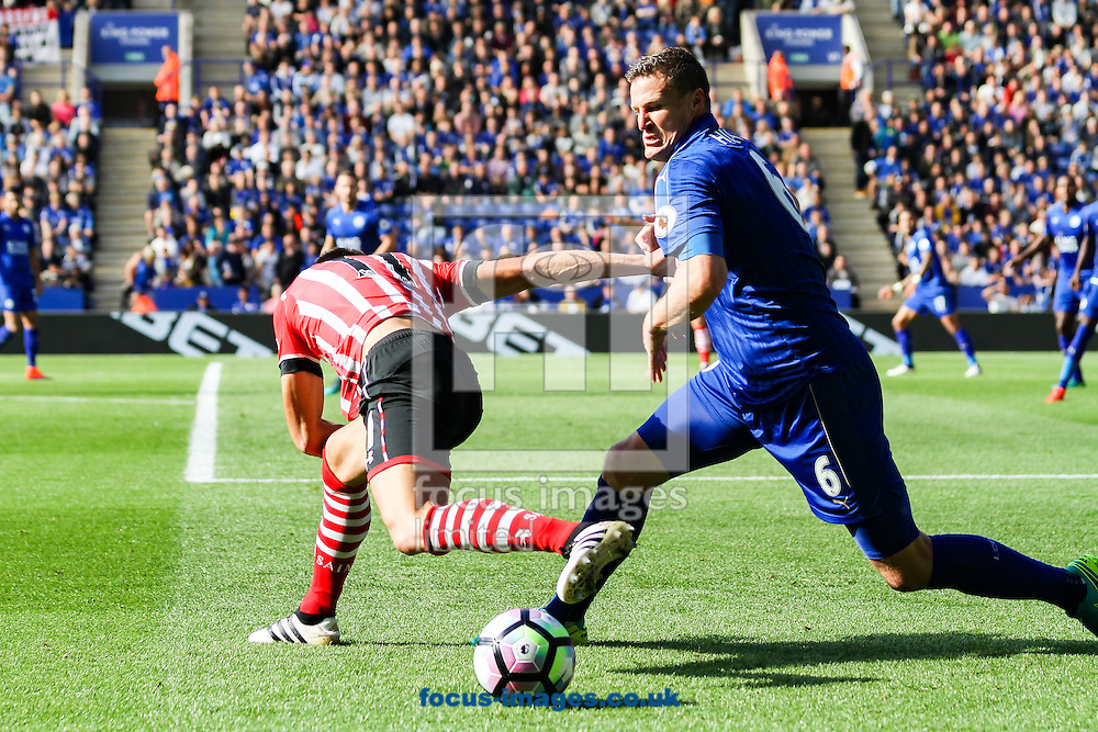 Robert Huth of Leicester City (right) competing with Dusan Tadic of Southampton (left) during the Premier League match at the King Power Stadium, Leicester<br /> Picture by Andy Kearns/Focus Images Ltd 0781 864 4264<br /> 02/10/2016