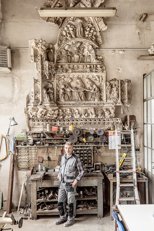Milan, La Veneranda Fabbrica del Duomo. this is the place where deteriored parts of the Milan Duomo are stocked and remade as new by local artisan. Chalk models in the machinery maintaenance lab
