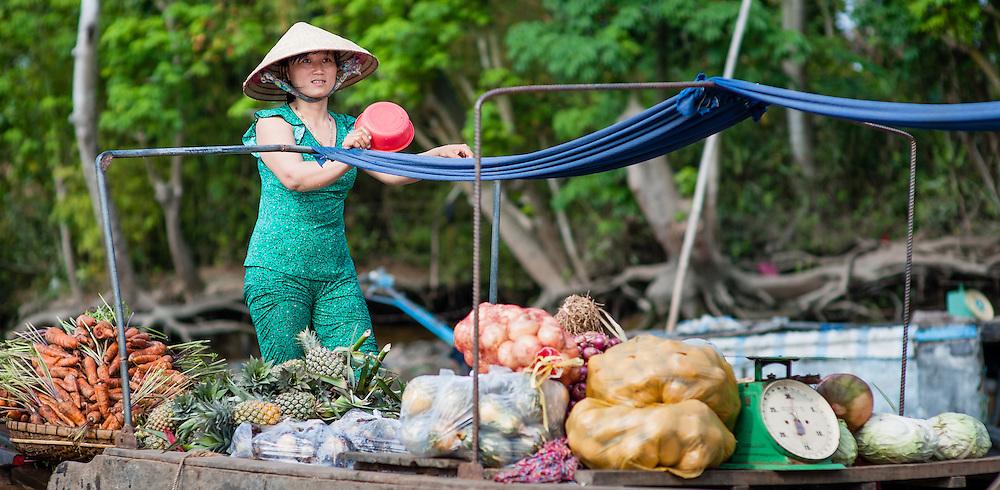 Vegetable seller on floatin market (Mekong Delta, Vietnam)