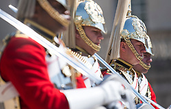 © Licensed to London News Pictures. 06/08/2018. London, UK.  Member son the Household Cavalry suffer in the heat during changing of the Guard ceremony on horse Guards Parade in central London as hot weather continues in the capital. Photo credit: Ben Cawthra/LNP