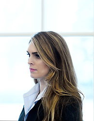 White House communications director Hope Hicks looks on during a meeting between President Trump and Don Bouvet, who has been battling cancer in the Oval Office of the White House, February 9, 2018 in Washington, DC, USA. Hope Hicks, one of President Trump's longest-serving advisers, is to step down as White House communications director. The 29-year-old former model has been by Mr Trump's side for years.The news came a day after she testified in front of the House Intelligence Committee, but White House sources said this was not the reason. Photo by Olivier Douliery/ABACAPRESS.COM