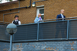© Licensed to London News Pictures. 04/07/2020. London, UK. A forensic officer and a detective officer in a residential area on Roman Way, Islington in north London as police launch a murder investigation following fatal shooting. Police were called at at 3.20pm to Roman Way, following reports of shots fired.  Officers attended with LAS and found a man, believed to be aged in his early 20s, suffering from gunshot injuries. Despite their best efforts, he was pronounced dead at the scene. Photo credit: Dinendra Haria/LNP