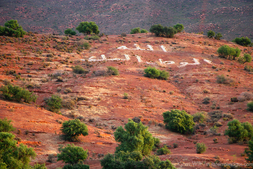 Africa, Morocco. Arabic message on foothills of Atlas mountain range.