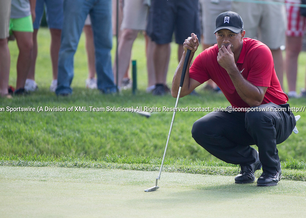 June 07 2015: Tiger Woods lining up a put during the final round of the Memorial Tournament held at the Muirfield Village Golf Club in Dublin, Ohio.