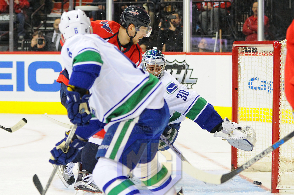 14 January 2016:  Washington Capitals center Evgeny Kuznetsov (92) scores against Vancouver Canucks goalie Ryan Miller (30) at the Verizon Center in Washington, D.C. where the Washington Capitals defeated the Vancouver Canucks, 4-1.  (Photograph by Mark Goldman/Icon Sportswire)