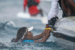 World Sailing Emerging Nations Program - Boca Chica Sailing Club, Santo Domingo 08/19/2017 - DAY 2 - Jalese Gordon from Antigua is grabbed by the hand next to a side boat during a tropical shower