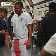 England fans looks claim on the way home after after England loss to Croatia the 2018 FIFA World Cup semi-finals in Moscow at the Hype park underground on 11 July 2018.