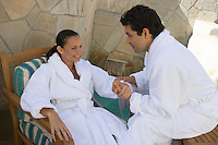 Couple in bathrobes relaxing outdoors