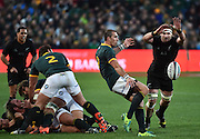 JOHANNESBURG, South Africa, 25 July 2015 : Kieran Read of the All Blacks tries to block a kick by Ruan Pienaar (V/C) of the Springboks during the Castle Lager Rugby Championship test match between SOUTH AFRICA and NEW ZEALAND at Emirates Airline Park in Johannesburg, South Africa on 25 July 2015. Bokke 20 - 27 All Blacks<br /> <br /> © Anton de Villiers / SASPA