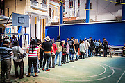 People cue to the pre-register on the voting site to discover the location of the designated voting table, La Paz. On Sunday, 12th October, President Evo Morales was re-elected for a third term by a majority of 60% and will turn into the longest serving President of the country if he finishes is mandate in 2020.
