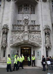 © Licensed to London News Pictures. 06/12/2016. London, UK. Police arrive at the Supreme Court on the second day of a hearing to appeal against a November 3 High Court ruling that Article 50 cannot be triggered without a vote in Parliament. Photo credit: Peter Macdiarmid/LNP