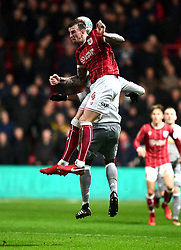 Aden Flint of Bristol City battles for the ball with  Anthony Martial of Manchester United  - Mandatory by-line: Joe Meredith/JMP - 20/12/2017 - FOOTBALL - Ashton Gate Stadium - Bristol, England - Bristol City v Manchester United - Carabao Cup Quarter Final