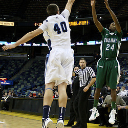 November 27, 2011; New Orleans, LA; Tulane Green Wave guard Jay Hook (24) shoots over San Diego Toreros forward Dennis Kramer (40) during the first half of Hoops for Hope Classic at the New Orleans Arena.  Mandatory Credit: Derick E. Hingle-US PRESSWIRE