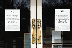 Edinburgh, Scotland, UK. 24 March, 2020. Waterstones bookshop closed with signs on the doors. All shops and restaurants are closed with very few people venturing outside following the Government imposed lockdown today. Pictured; Iain Masterton/Alamy Live News