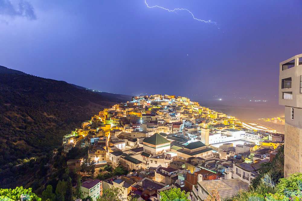 View over the Medina of Moulay Idriss Zerhoun at night, Middle Atlas, Morocco, 2016-06-01.