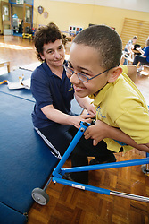 Child with Cerebral Palsy exercising,