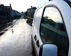 © Licensed to London News Pictures. 29/12/15<br /> York, UK. <br /> <br /> The high water mark can be seen on the side window of a van as flood water now begins to subside on Huntington Road in York. Further rainfall is expected over coming days as Storm Frank approaches the east coast of the country.<br /> <br /> Photo credit : Ian Forsyth/LNP