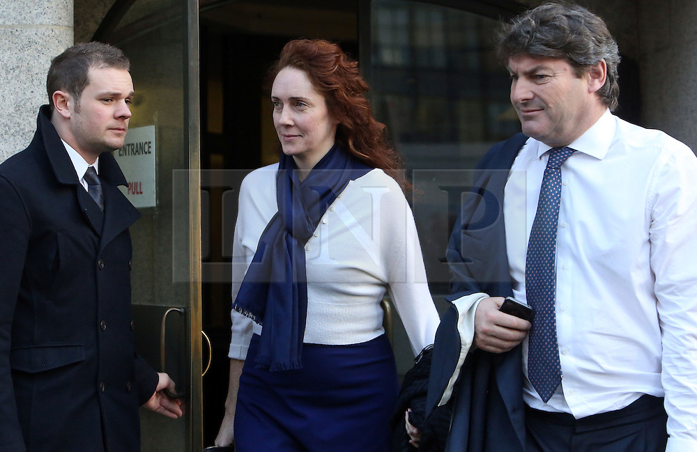 &copy; Licenced to London News Pictures. 20/02/2014. London. UK.  <br /> Former News of the World editor Rebekah Brooks is pictured leaving the Central Criminal Court with her husband Charlie during her week of giving evidence at the phone-hacking trial at the Old Bailey in London, February 20th 2014.<br /> Photo Credit: Susannah Ireland