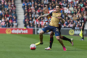 Arsenal defender Hector Bellerin (24) and Sunderland's Midfielder Wahbi Khazri (22) compete during the Barclays Premier League match between Sunderland and Arsenal at the Stadium Of Light, Sunderland, England on 24 April 2016. Photo by George Ledger.