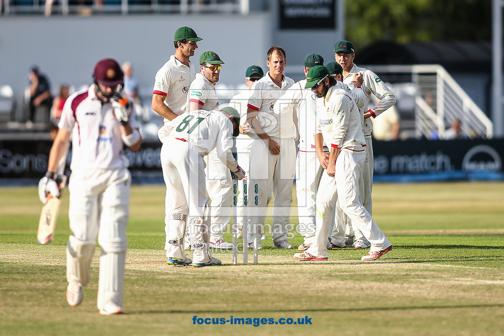 Leicestershire players celebrate taking the wicket of Rob Keogh of Northamptonshire CCC (left) during the Specsavers County C'ship Div Two match at the County Ground, Northampton<br /> Picture by Andy Kearns/Focus Images Ltd 0781 864 4264<br /> 14/08/2016