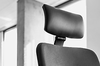 Black and white photo of chair in office