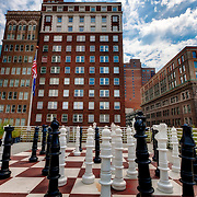 Oversized chess pieces on rooftop of downtown Kansas City Central Branch library at 10th and Baltimore Streets. View of 21 Ten Condos across street in middle, Library Lofts at right.
