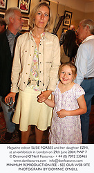 Magazine editor SUSIE FORBES and her daughter EZMI, at an exhibition in London on 29th June 2004.PWP 7