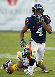 Virginia cornerback Vic Hall (4) reacts after intercepting a pass intended for Georgia Tech running back Roddy Jones (20) to seal the game late in the fourth quarter.  The Virginia Cavaliers defeated the #18 ranked Georgia Tech Yellow Jackets 24-17 in NCAA Division 1 Football at Bobby Dodd Stadium on the campus of Georgia Tech in Atlanta, GA on October 25, 2008.